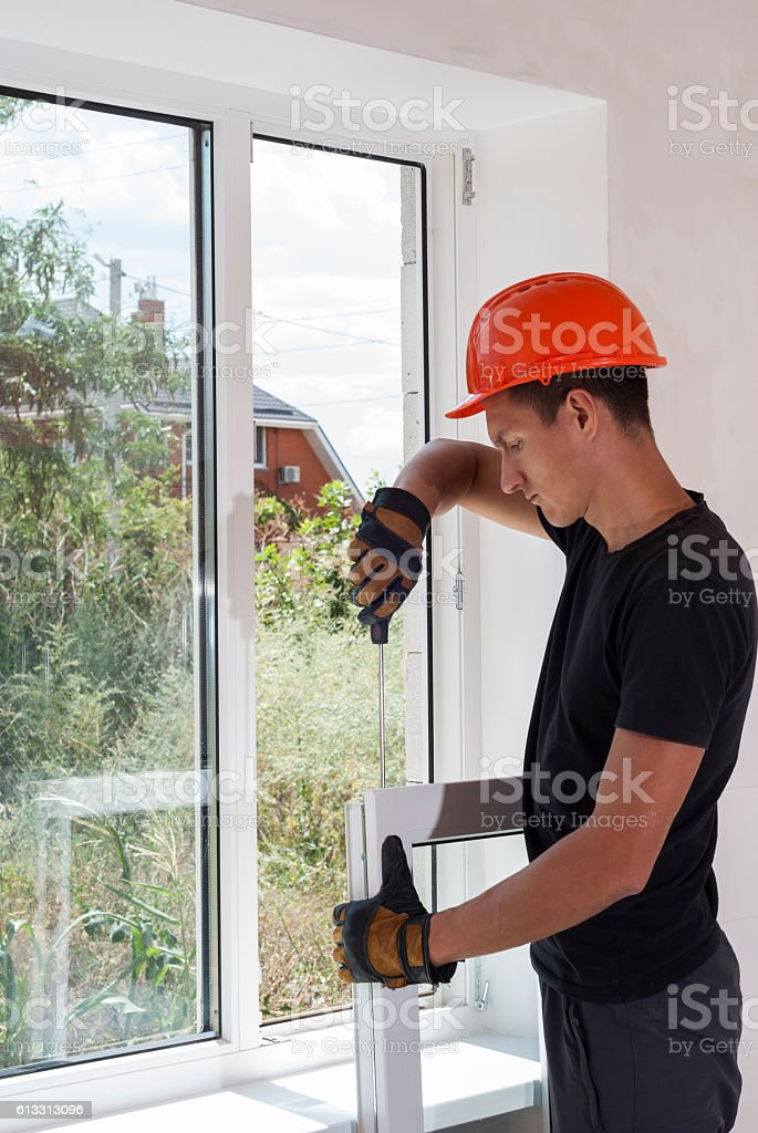 installation and repair of plastic windows stock photo