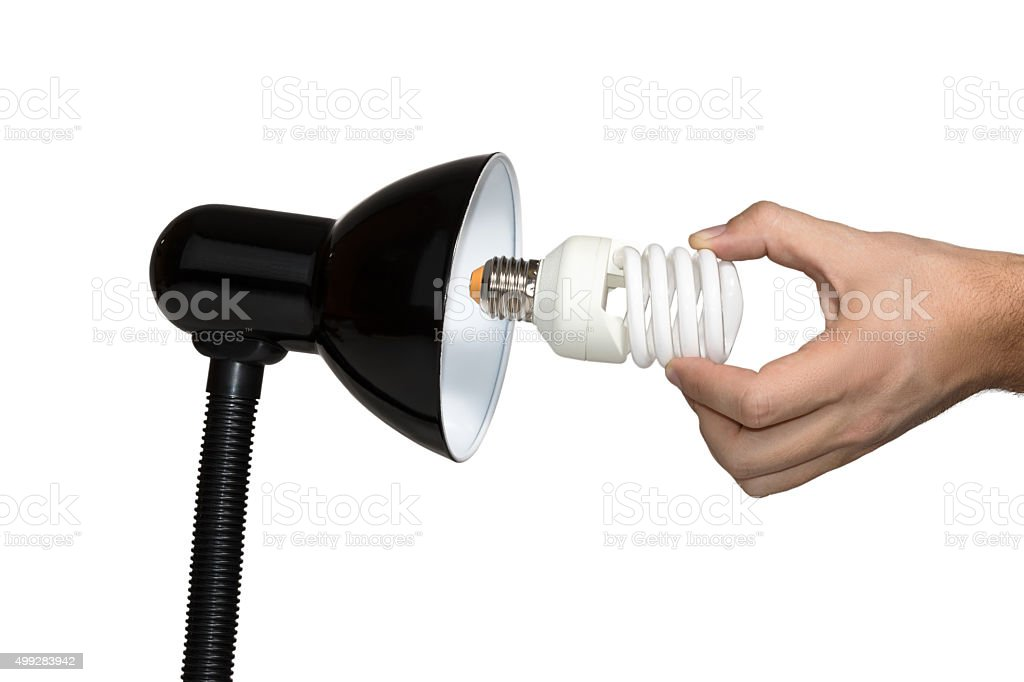 Installation of a modern economical bulb stock photo