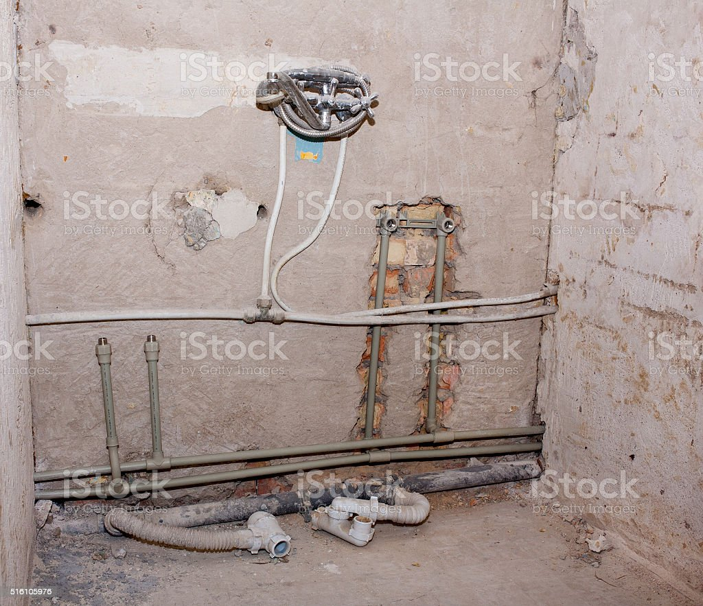 Installation of a polymeric pipe stock photo