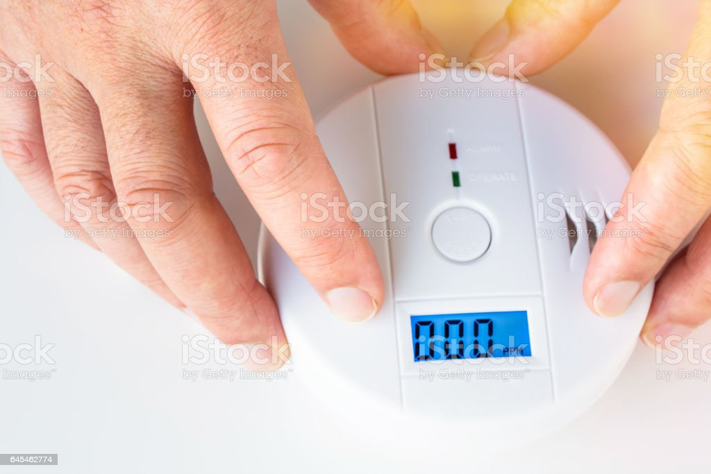 Installation of a smoke and fire alarm with carbon monoxide sensor capability stock photo