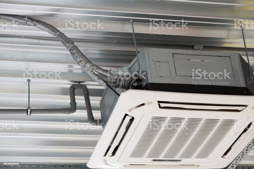 installation of air conditioning on the ceiling stock photo