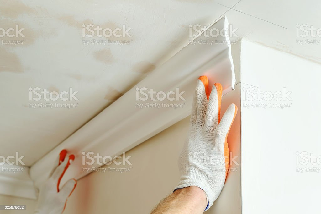 Installation of ceiling moldings. royalty-free stock photo