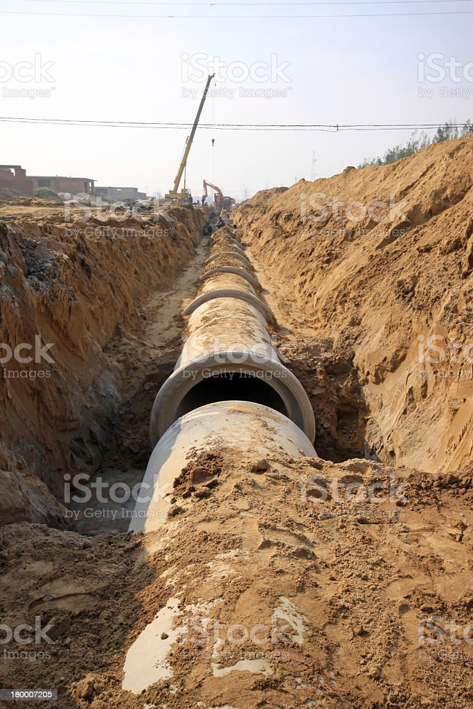 Installation of concrete drainage pipe in sandy ground stock photo
