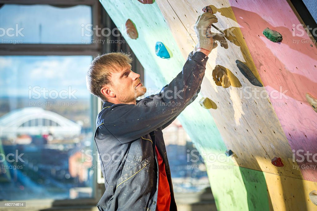 Installation Of Equipment For Indoor Rock Climbing stock photo