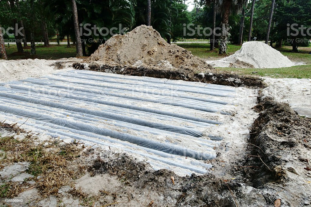 Installation of new septic tank drainage field stock photo