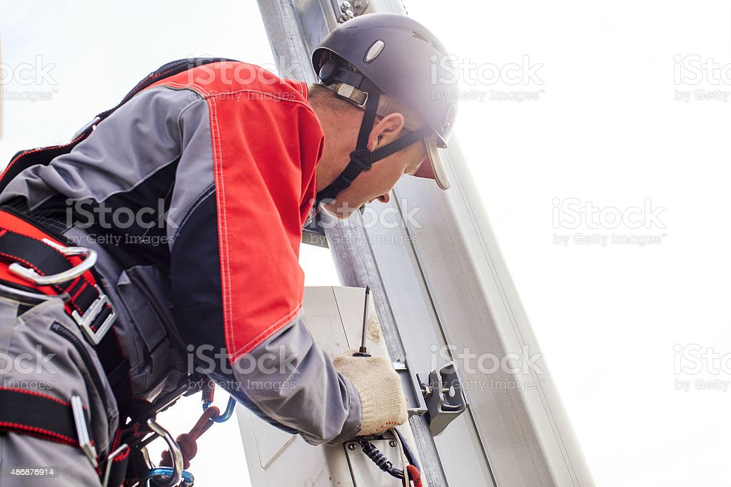 installation of telecommunication equipments stock photo