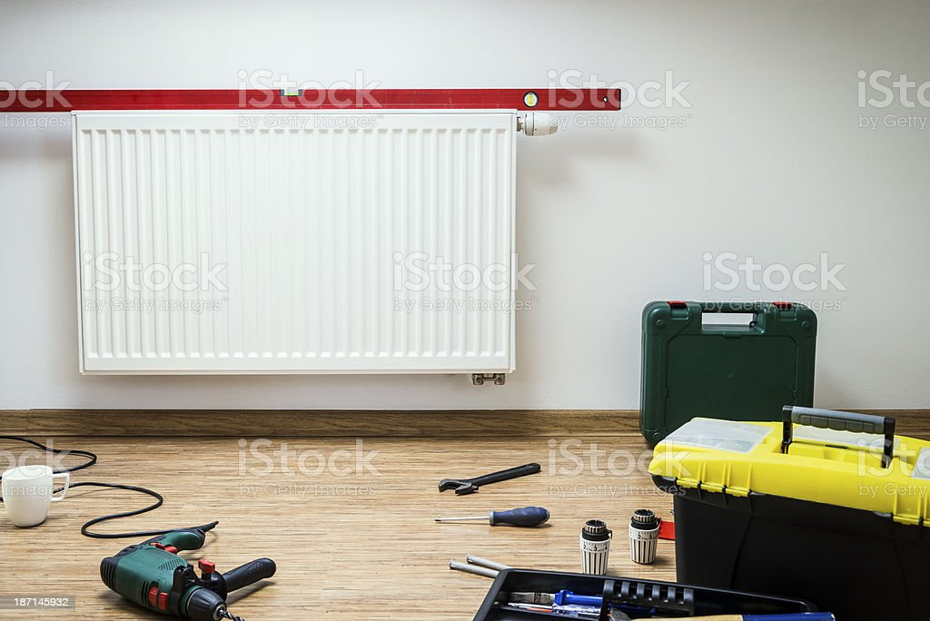 Installation of the heater, tools, coffee break, home interior royalty-free stock photo