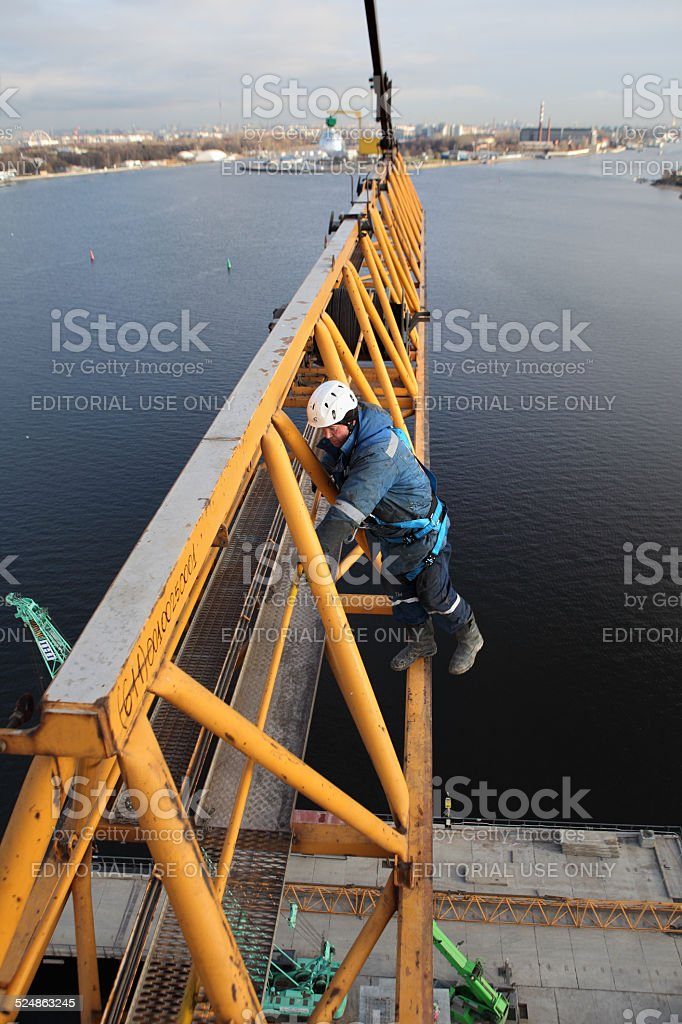 installation section of tower crane at height, assembly fitters steeplejacks. stock photo