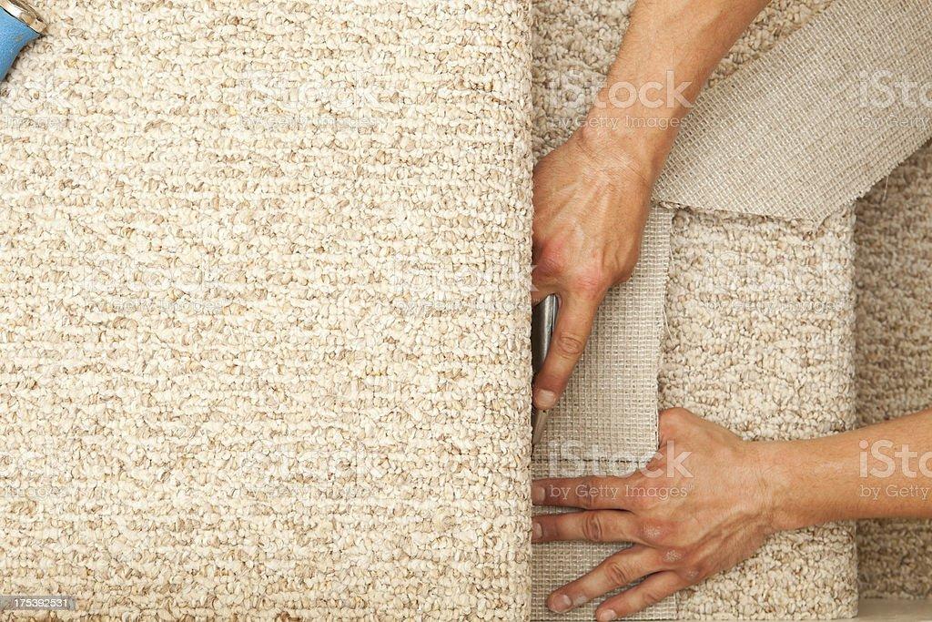 Installer Trimming New Stair Carpet stock photo