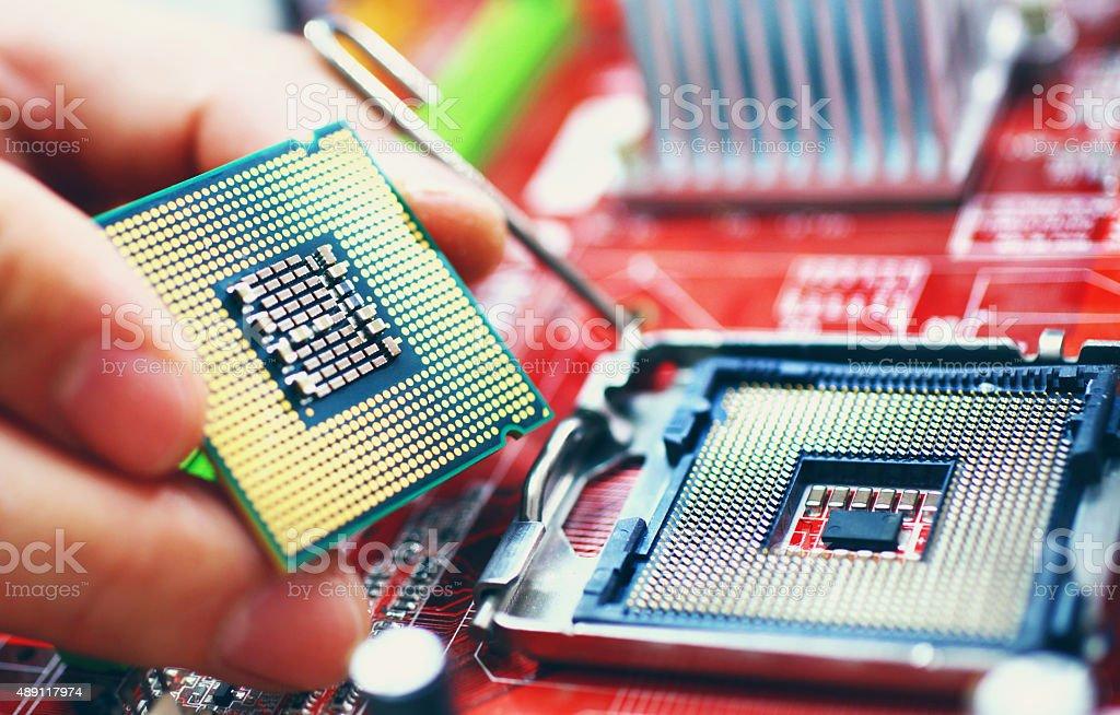 Installing a CPU. stock photo