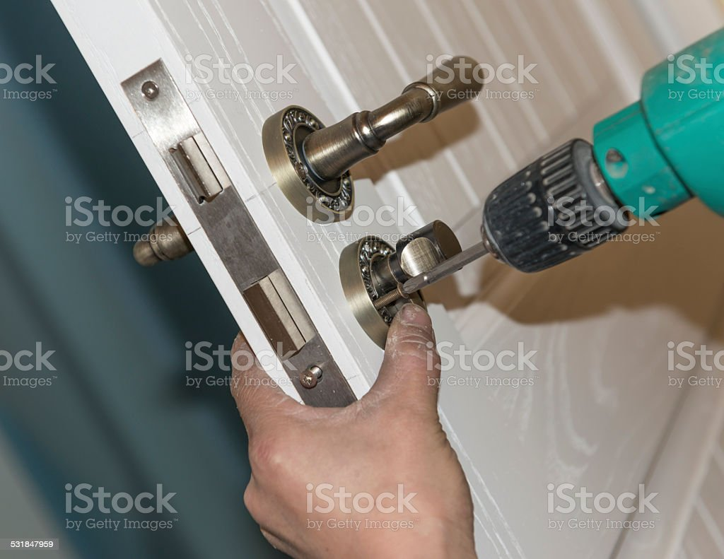 Installing a lock stock photo