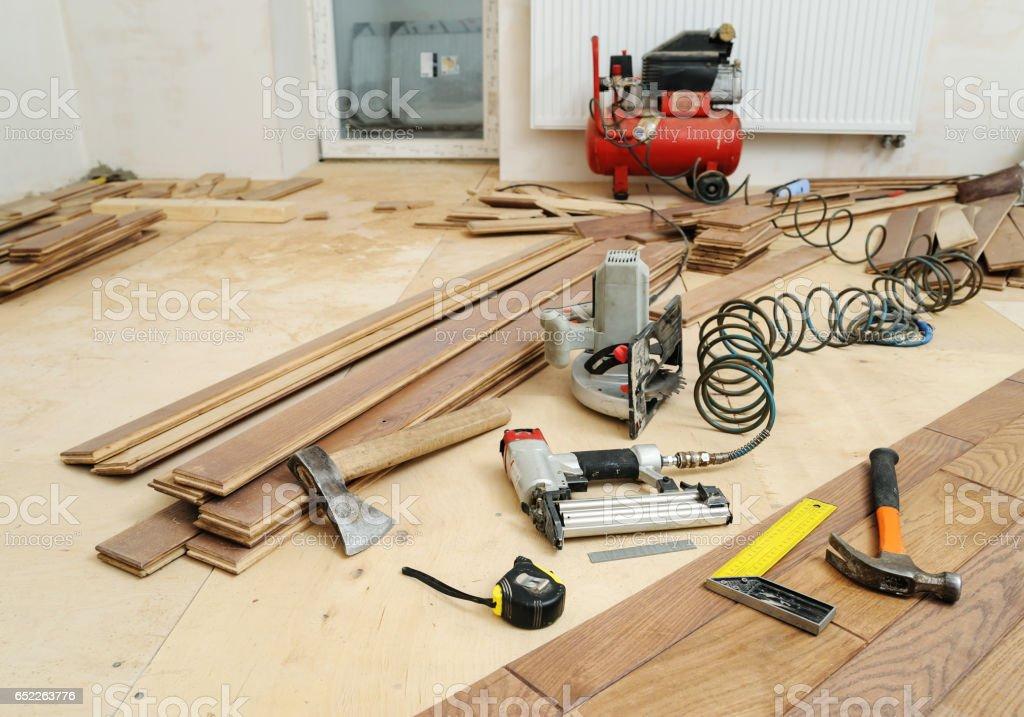 Installing a wooden floor. stock photo