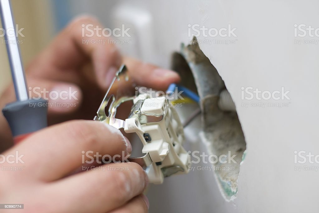 Installing an electrical plug / contact stock photo