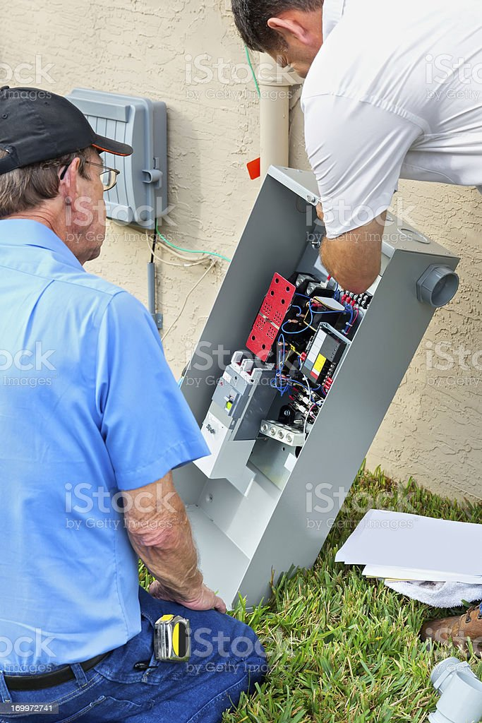 Installing an inground generator royalty-free stock photo