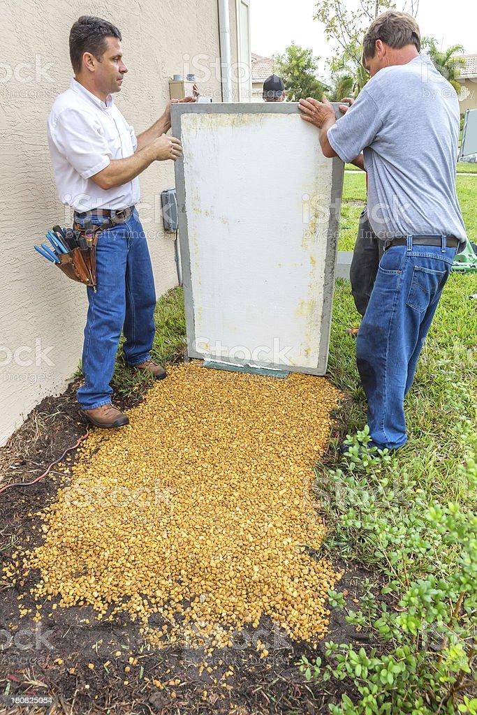 Installing an inground generator royalty-free stock photo