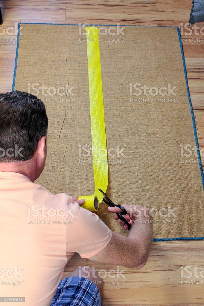 Installing Anti Slip Rug Tape stock photo