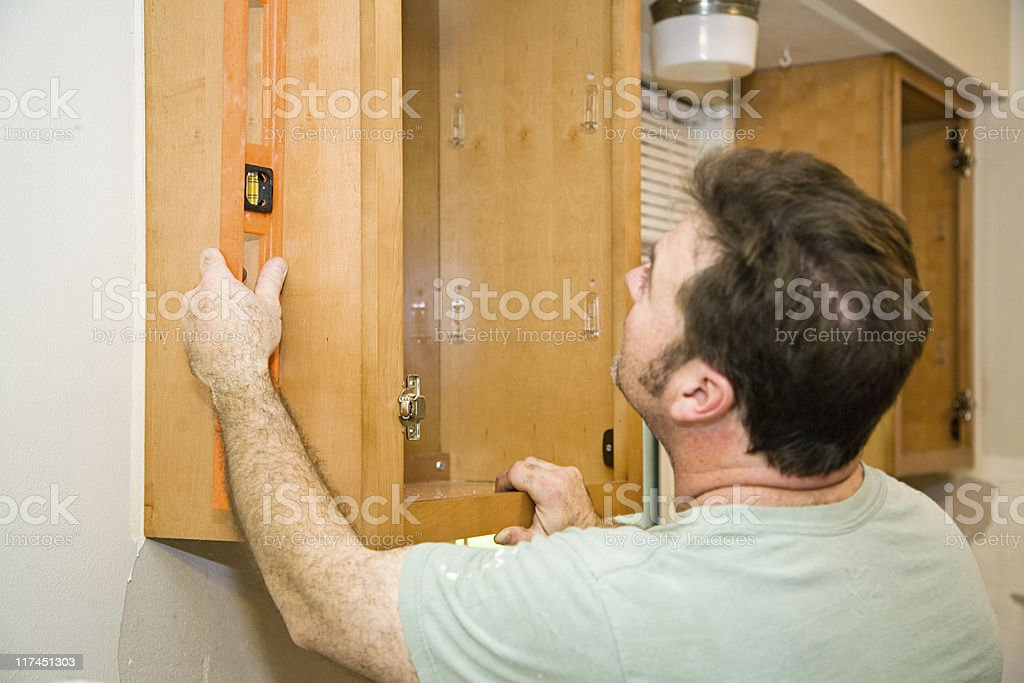 Installing Cabinets - Leveling royalty-free stock photo