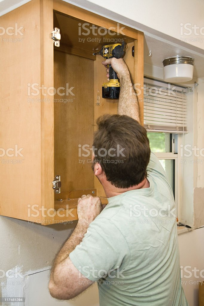 Installing Cabinets royalty-free stock photo