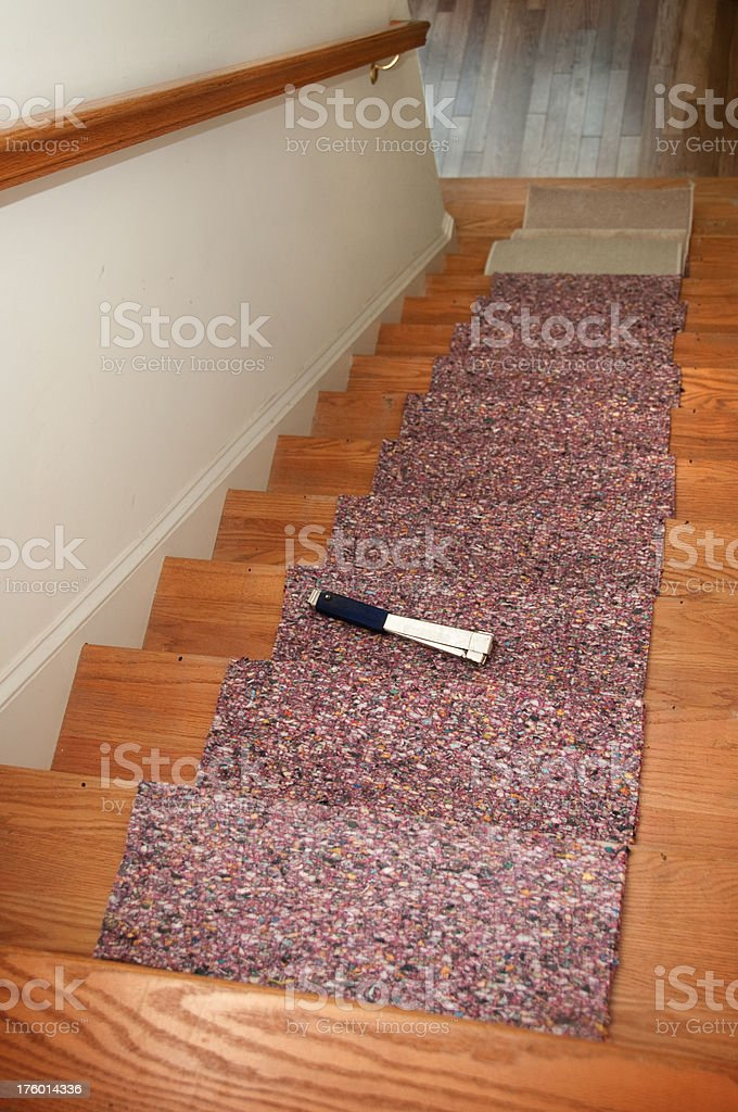 installing carpet padding stock photo