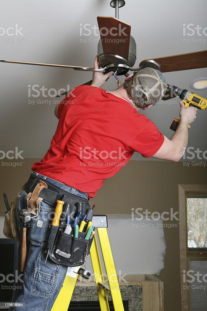 Installing Ceiling Fan royalty-free stock photo