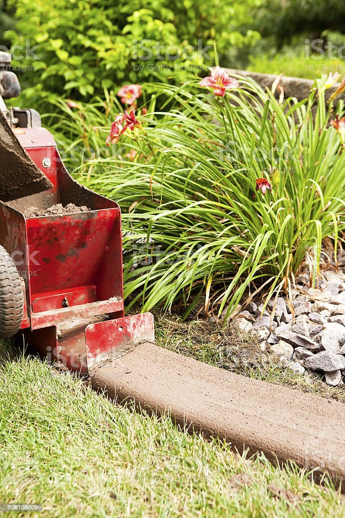Installing Concrete Edging / Curbing Between Lawn and Landscaping stock photo