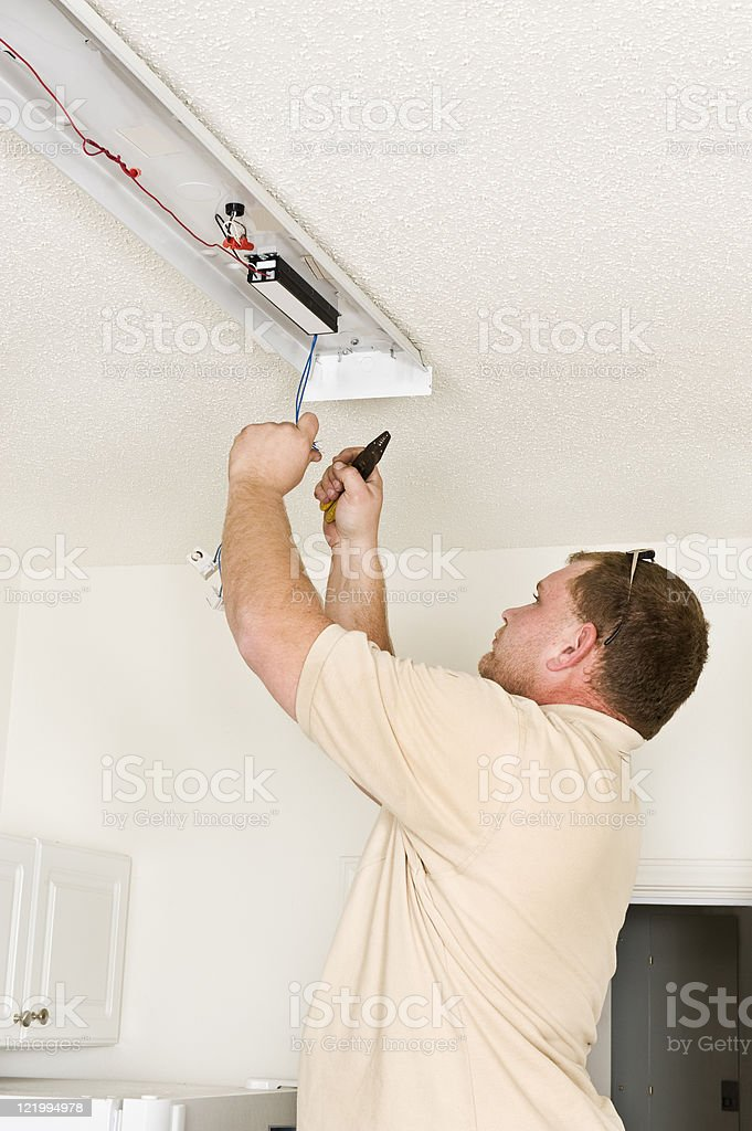 Installing Fluorescent Lighting Fixture royalty-free stock photo