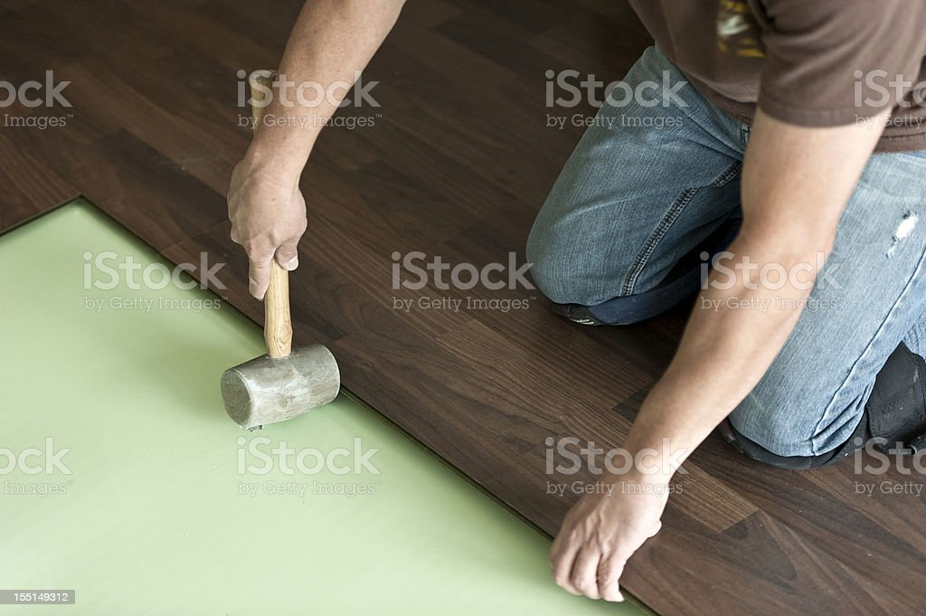 Installing hardwood floor stock photo
