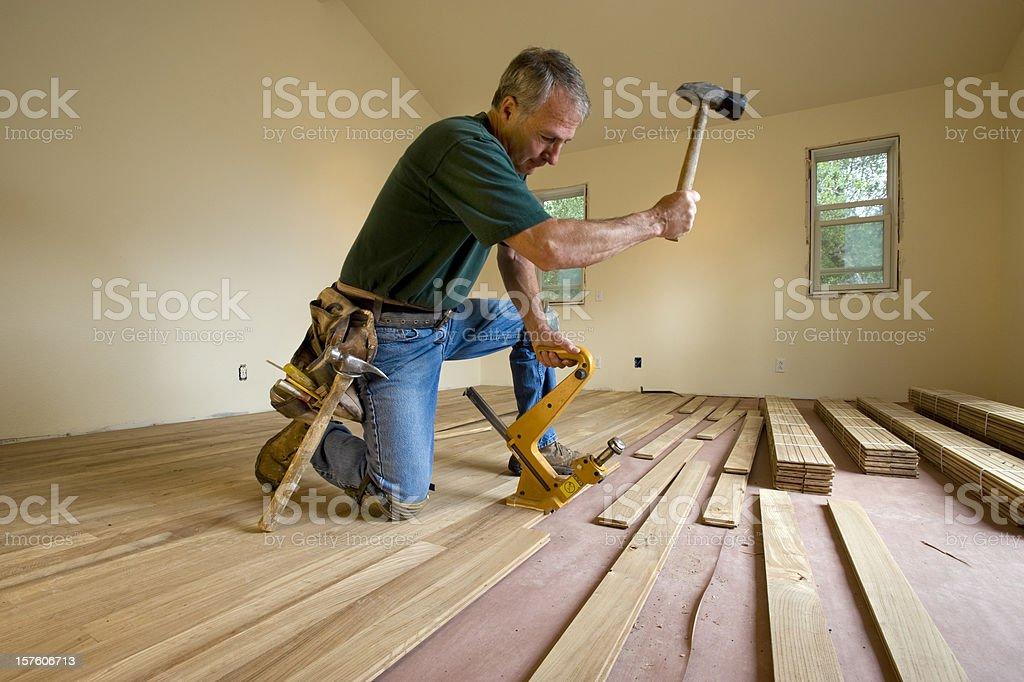 Installing Hardwood Flooring royalty-free stock photo