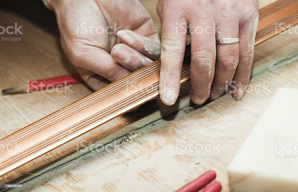 Installing Hardwood floors royalty-free stock photo