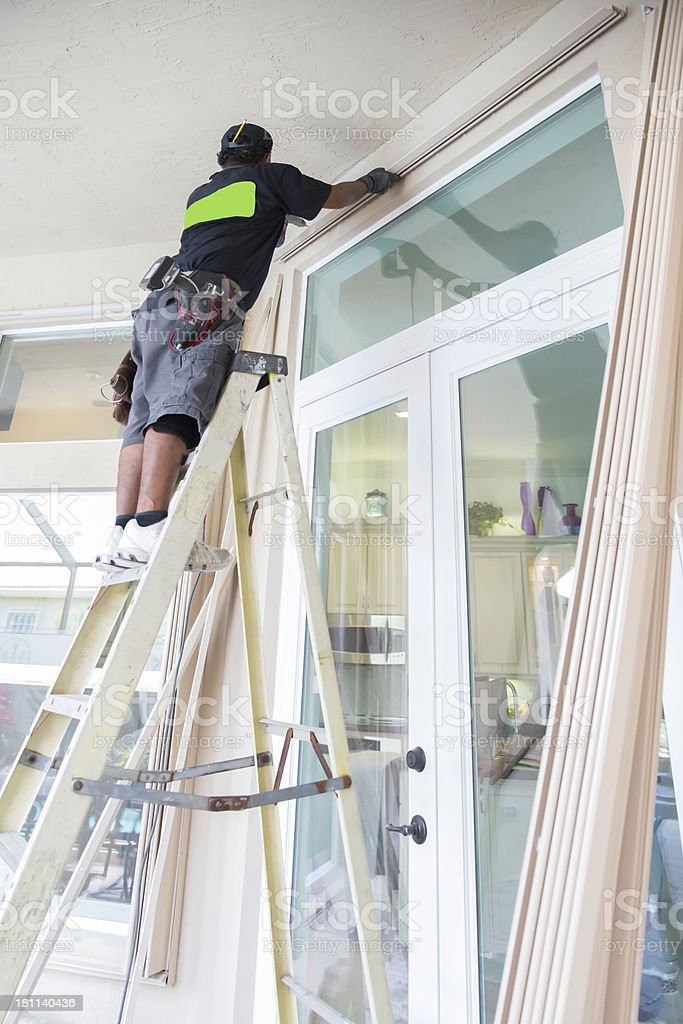 Installing Hurricane Shutters stock photo