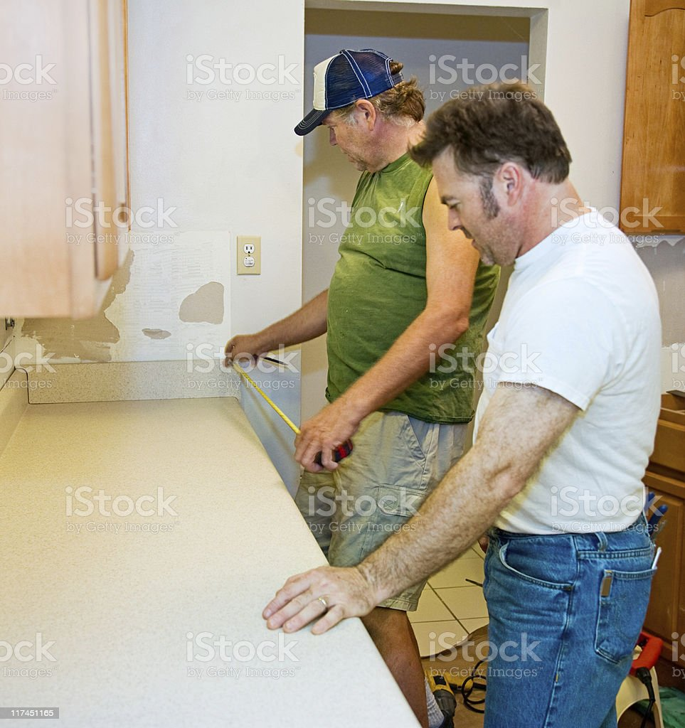Installing Kitchen Counter - Measuring royalty-free stock photo