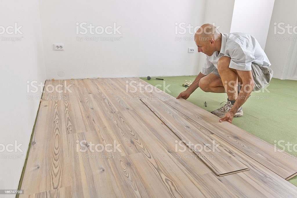 Installing Laminate Floor During Home Addition royalty-free stock photo
