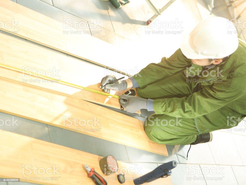 Installing Laminated Floor stock photo