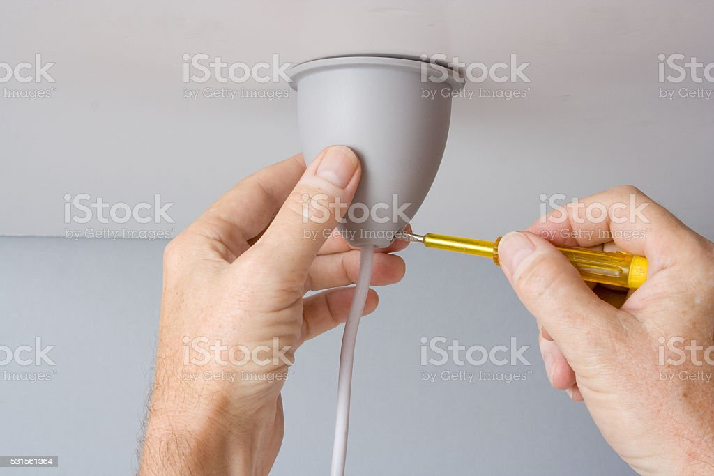 Installing light fixture stock photo