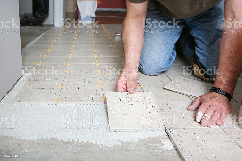Installing Luxury Floor Tiles royalty-free stock photo