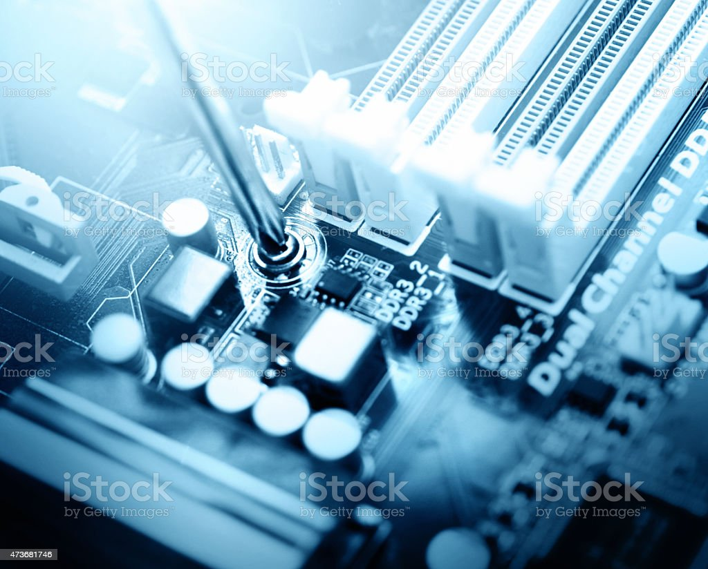 Installing motherboard into computer case. stock photo