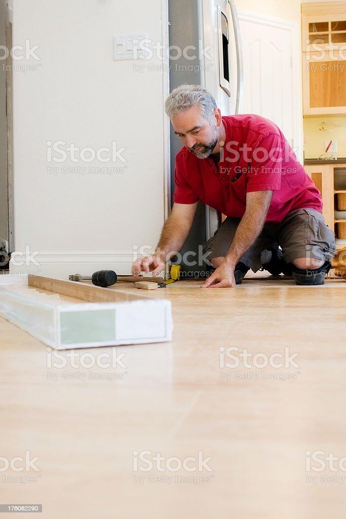 installing new flooring royalty-free stock photo