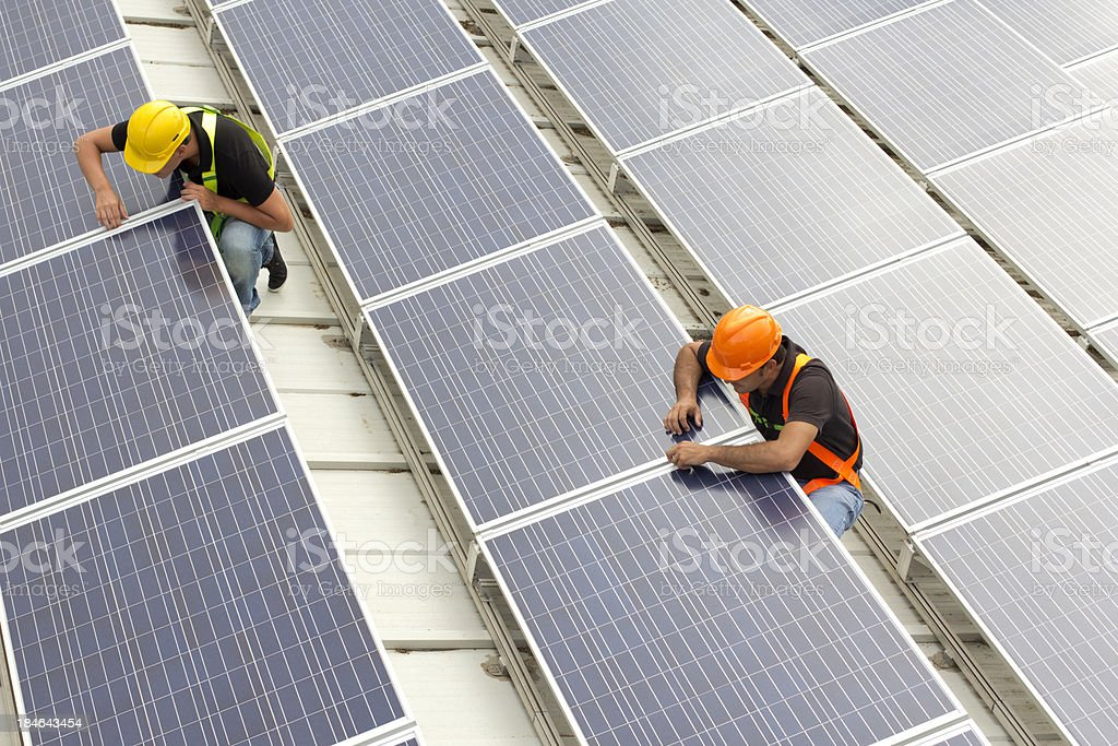 Installing Panels stock photo