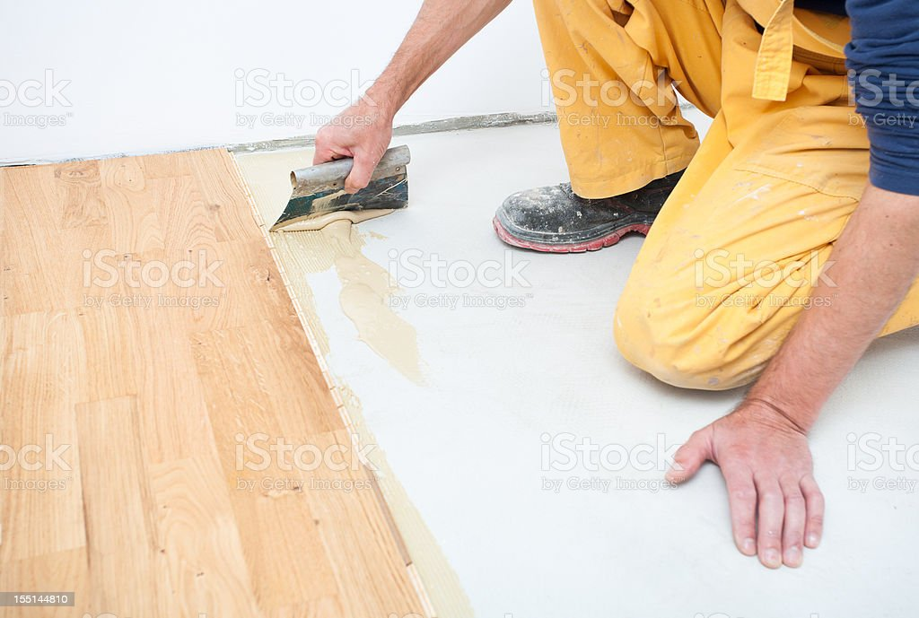 Installing parquet  floor royalty-free stock photo