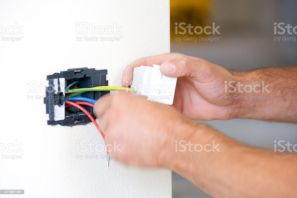 Installing power outlet royalty-free stock photo
