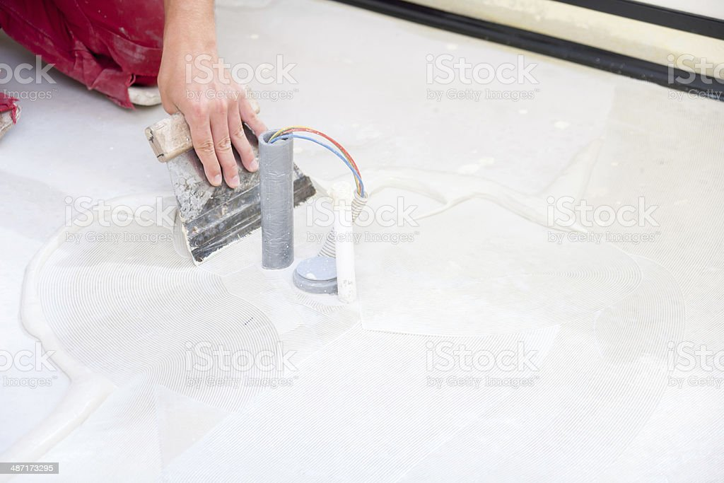 Installing PVC floor stock photo
