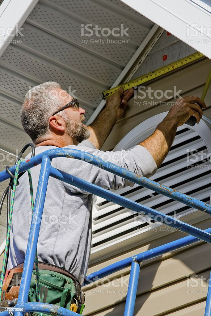 installing siding royalty-free stock photo
