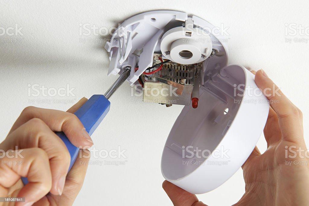 Installing Smoke Detector At Home stock photo