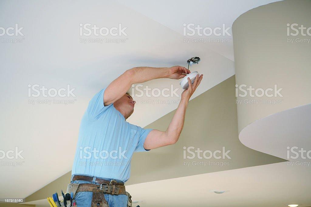 Installing Smoke Detector stock photo