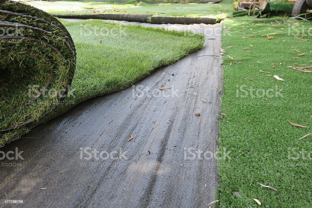 Installing synthetic grass stock photo