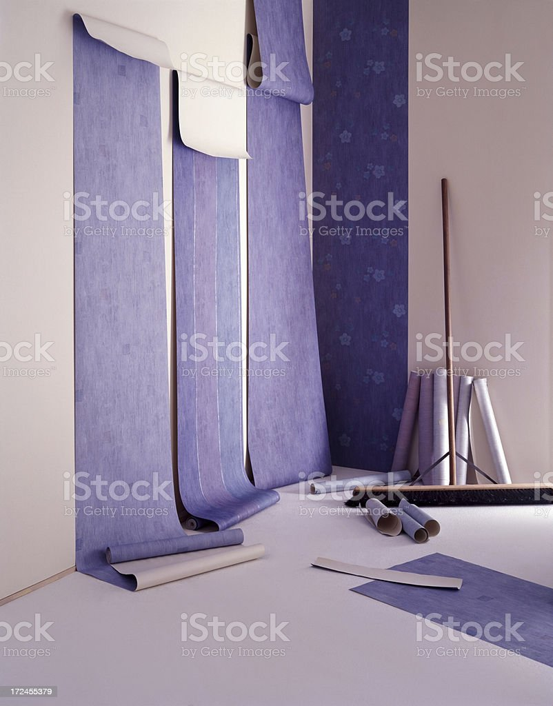 Installing wallpaper in new apartment royalty-free stock photo