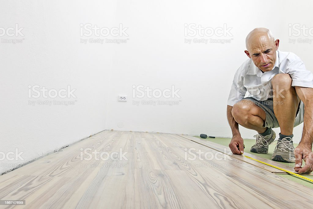 Installing Wooden Floor During Home Addition royalty-free stock photo