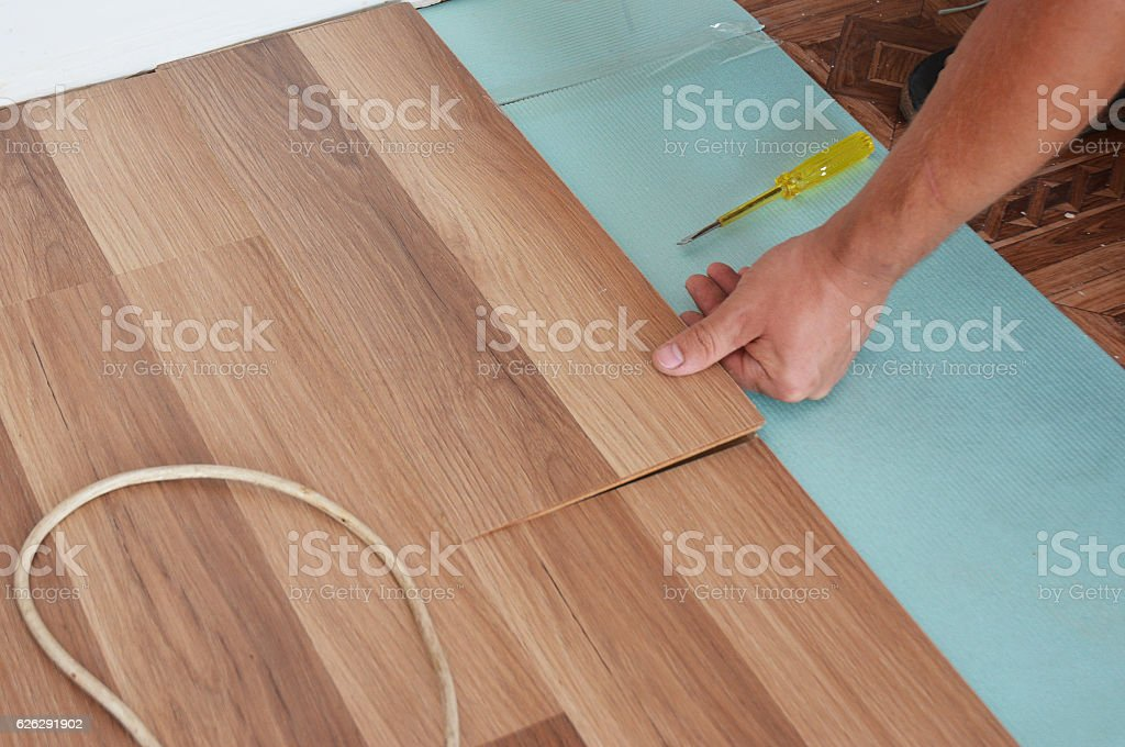 Installing wooden laminate flooring. Step by Step. stock photo