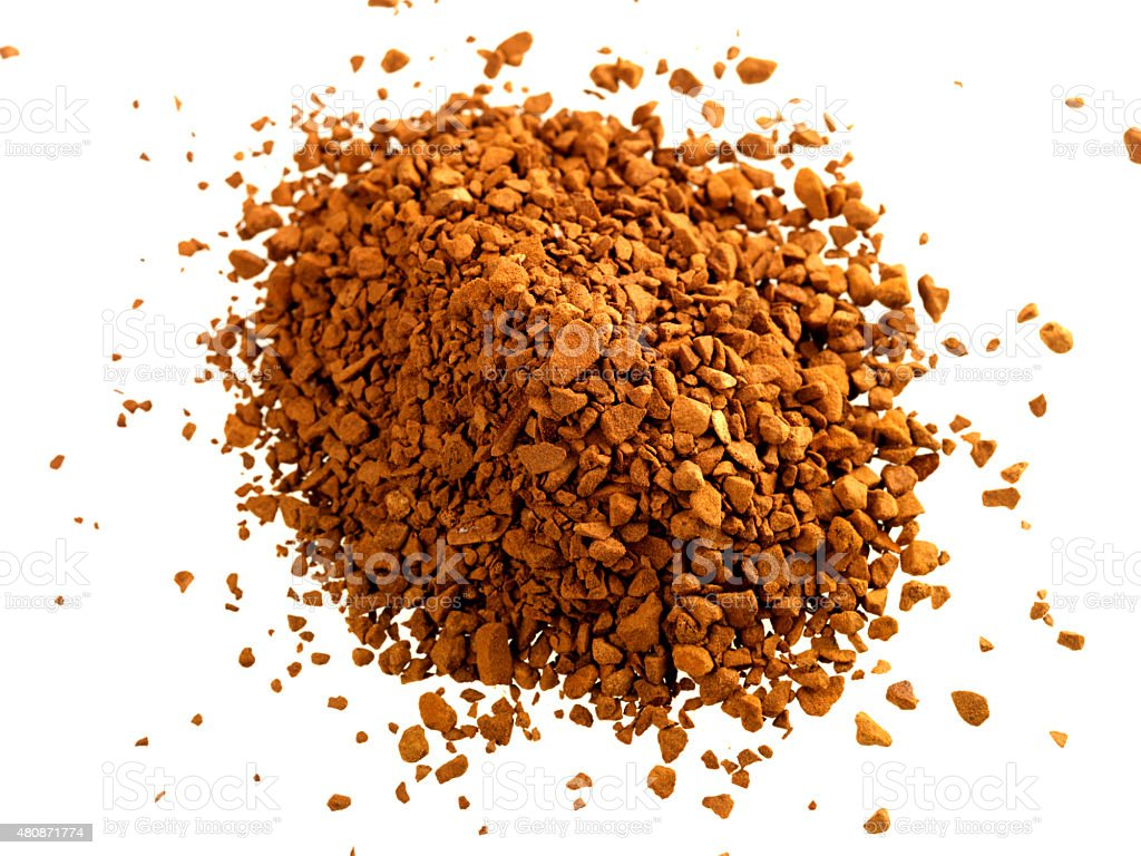 Instant Coffee Granules Shot Against a White Background stock photo