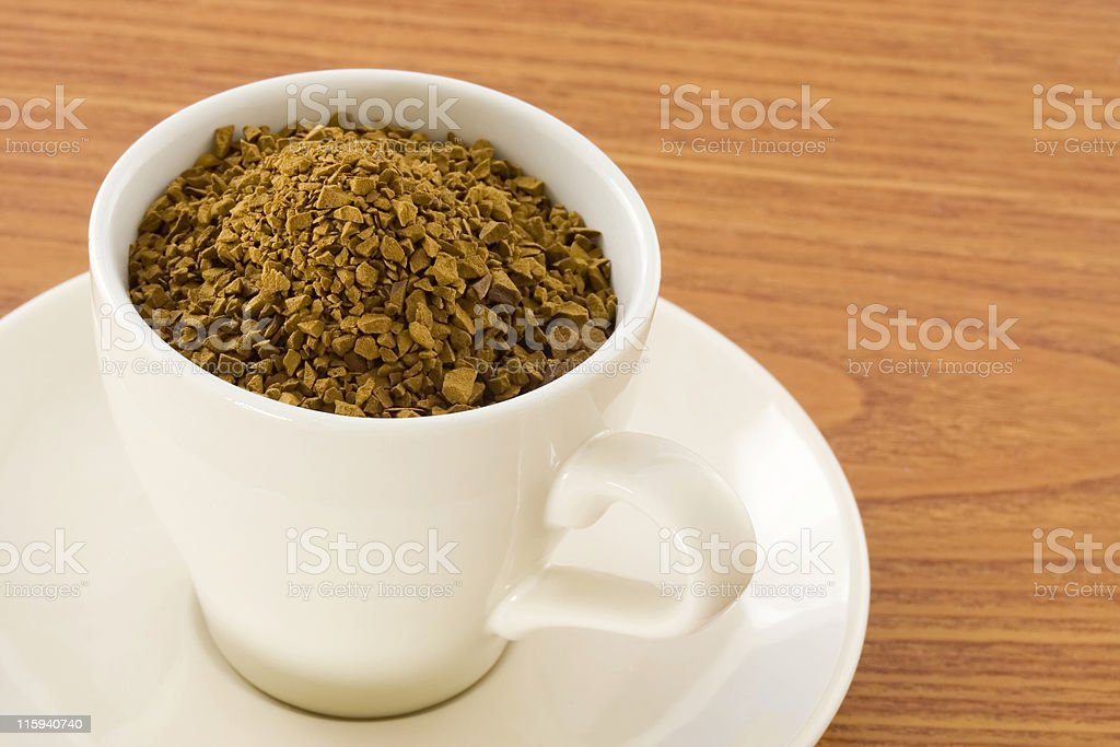 Instant coffee powder in a cup royalty-free stock photo